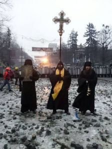 January 2014 Monks stand between police and demonstrators in Kiev